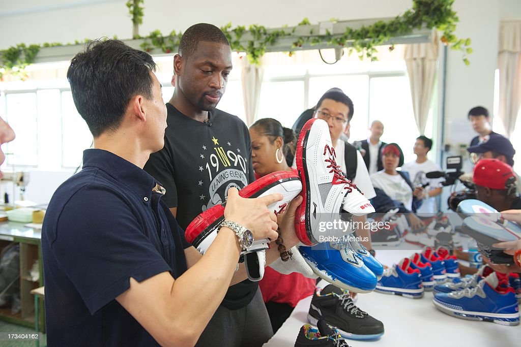 <a gi-track='captionPersonalityLinkClicked' href=/galleries/search?phrase=Dwyane+Wade&family=editorial&specificpeople=201481 ng-click='$event.stopPropagation()'>Dwyane Wade</a> inspects a new batch of 'Way of Wade' shoes for quality control at the Li-Ning shoe manucaturing factory on July 12, 2013 in Tai Cang, China.