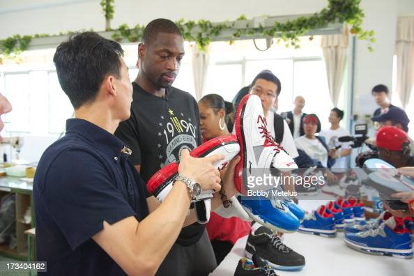 Dwyane Wade inspects a new batch of 'Way of Wade' shoes for quality control at the LiNing shoe manucaturing factory on July 12 2013 in Tai Cang China