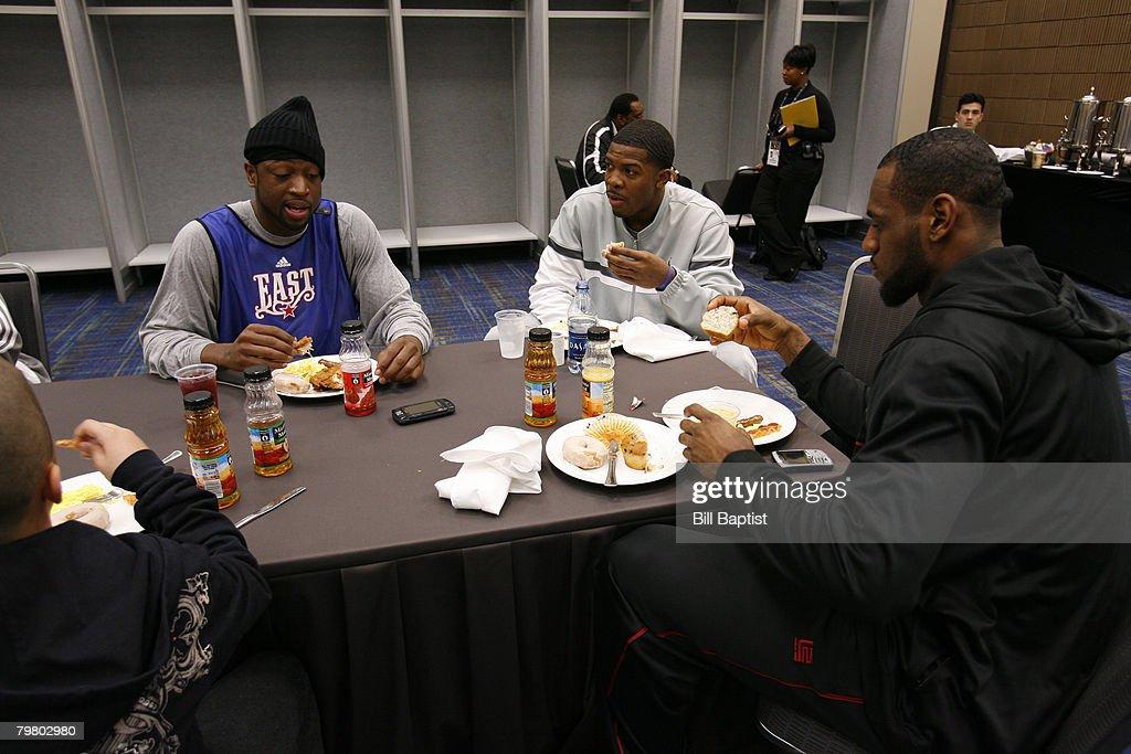 Dwyane Wade Joe Johnson and LeBron James of the East AllStars eat breakfast prior to the East AllStars Practice on center court at NBA Jam Session...