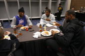 Dwyane Wade Joe Johnson and LeBron James of the East AllStars eat breakfast prior to the East AllStars Practice on center court at NBA Jam Session...