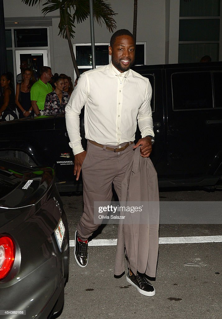 <a gi-track='captionPersonalityLinkClicked' href=/galleries/search?phrase=Dwyane+Wade&family=editorial&specificpeople=201481 ng-click='$event.stopPropagation()'>Dwyane Wade</a> leave their wedding rehearsal dinner at Prime 112 Steakhouse on August 29, 2014 in Miami Beach, Florida.
