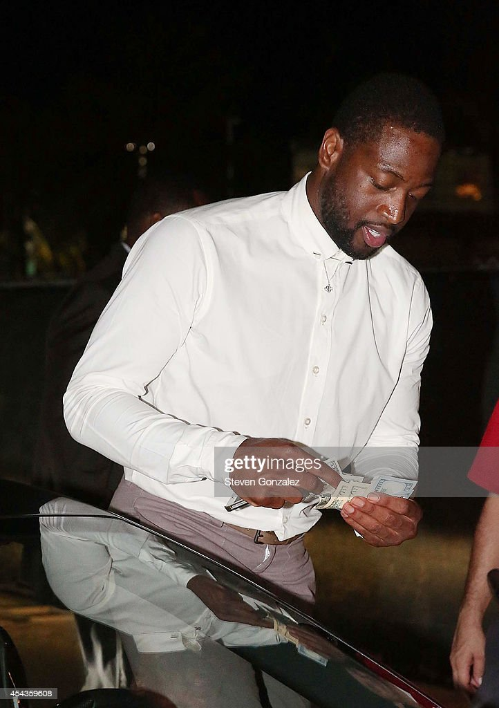 Dwyane Wade leaves his wedding rehearsal dinner at Prime 112 Steakhouse on August 29, 2014 in Miami Beach, Florida.