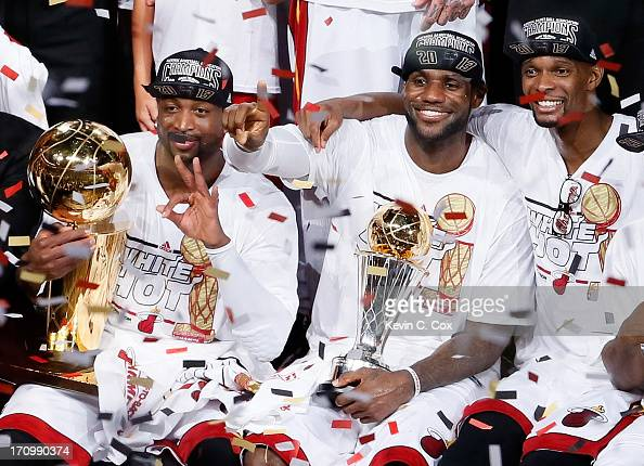 Dwyane Wade LeBron James and Chris Bosh of the Miami Heat celebrate after defeating the San Antonio Spurs 9588 to win Game Seven of the 2013 NBA...