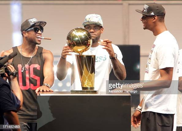 Dwyane Wade LeBron James and Chris Bosh of the Miami Heat celebrates the NBA Championship victory rally at the AmericanAirlines Arena on June 24 2013...