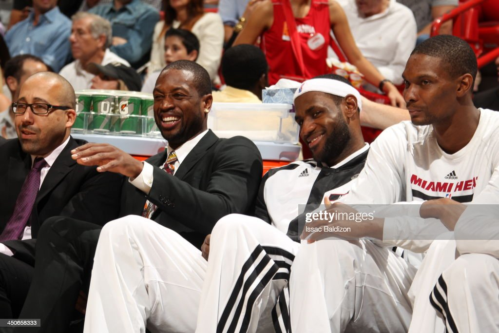 <a gi-track='captionPersonalityLinkClicked' href=/galleries/search?phrase=Dwyane+Wade&family=editorial&specificpeople=201481 ng-click='$event.stopPropagation()'>Dwyane Wade</a> #3, <a gi-track='captionPersonalityLinkClicked' href=/galleries/search?phrase=LeBron+James&family=editorial&specificpeople=201474 ng-click='$event.stopPropagation()'>LeBron James</a> #6, and <a gi-track='captionPersonalityLinkClicked' href=/galleries/search?phrase=Chris+Bosh&family=editorial&specificpeople=201574 ng-click='$event.stopPropagation()'>Chris Bosh</a> #1 of the Miami Heat smile while on the bench during the game against the Atlanta Hawks on November 19, 2013 at American Airlines Arena in Miami, Florida.