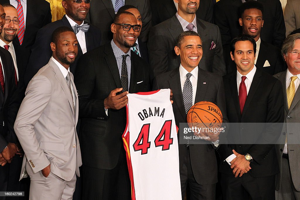 <a gi-track='captionPersonalityLinkClicked' href=/galleries/search?phrase=Dwyane+Wade&family=editorial&specificpeople=201481 ng-click='$event.stopPropagation()'>Dwyane Wade</a> #3, <a gi-track='captionPersonalityLinkClicked' href=/galleries/search?phrase=LeBron+James&family=editorial&specificpeople=201474 ng-click='$event.stopPropagation()'>LeBron James</a> #6 and Head Coach Eric Spoelstra of the Miami Heat take a photo with President <a gi-track='captionPersonalityLinkClicked' href=/galleries/search?phrase=Barack+Obama&family=editorial&specificpeople=203260 ng-click='$event.stopPropagation()'>Barack Obama</a> during a visit by the Miami Heat to the White House to commemorate the 2012 NBA Champions on January 28, 2013 in Washington, DC.