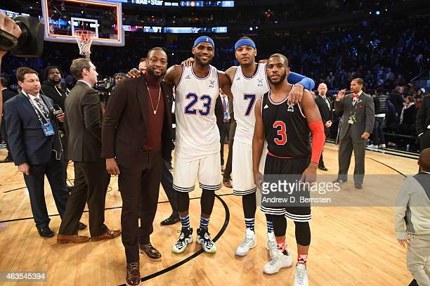 Dwyane Wade LeBron James Carmelo Anthony of the Eastern Conference pose for a photo with Chris Paul of the Western Conference after the 64th NBA...