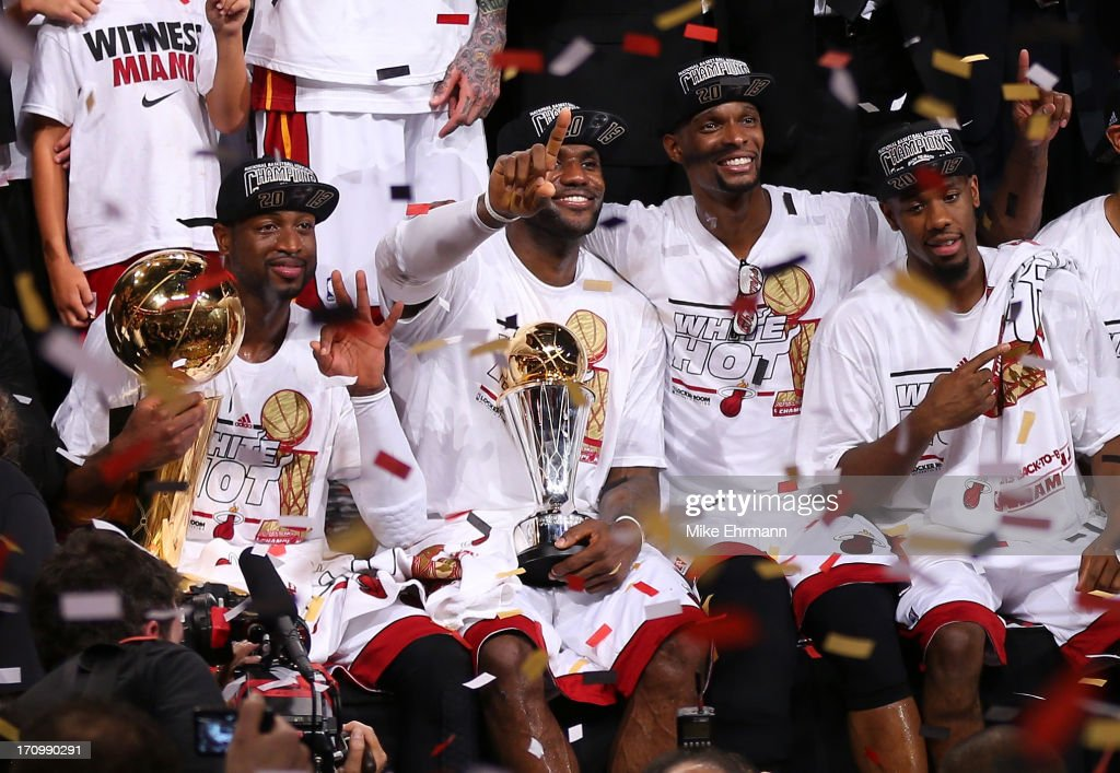 Dwyane Wade #3, LeBron James #6, Chris Bosh #1 and Norris Cole #30 of the Miami Heat celebrate after defeating the San Antonio Spurs 95-88 to win Game Seven of the 2013 NBA Finals at AmericanAirlines Arena on June 20, 2013 in Miami, Florida.
