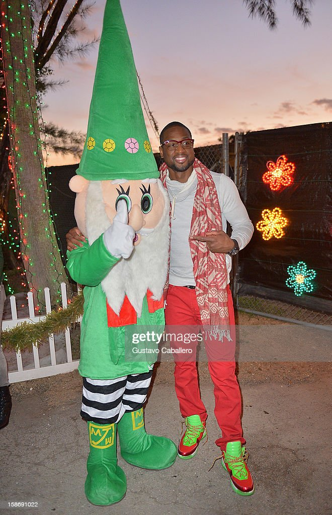 Dwyane Wade make an appearance on behalf of Wade's World Foundation at Santa's Enchanted Forest on December 23, 2012 in Miami, Florida.