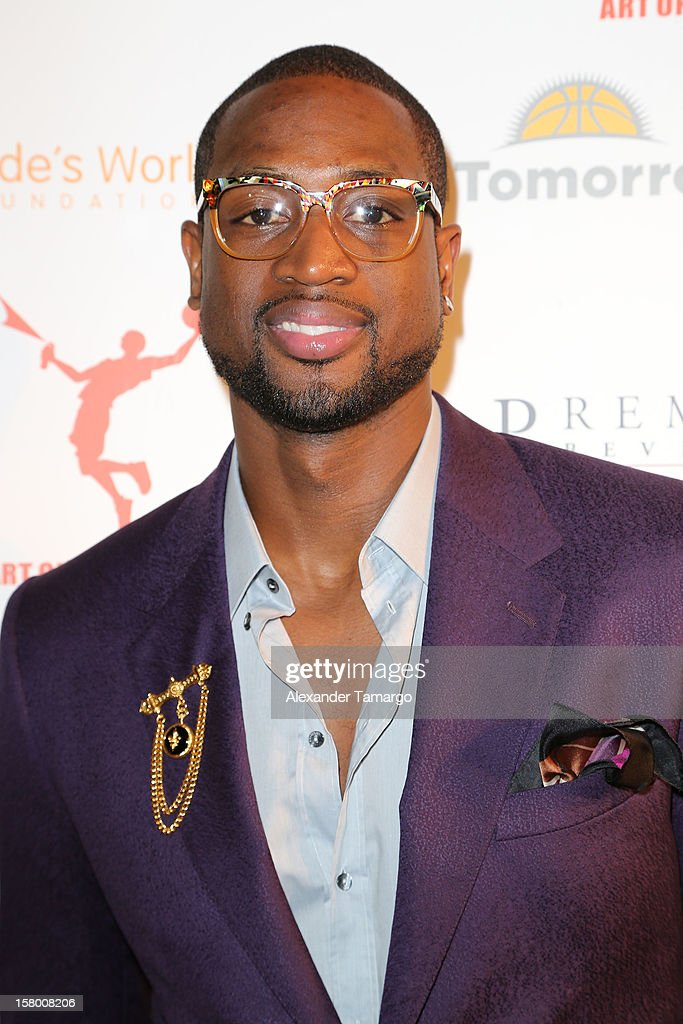 <a gi-track='captionPersonalityLinkClicked' href=/galleries/search?phrase=Dwyane+Wade&family=editorial&specificpeople=201481 ng-click='$event.stopPropagation()'>Dwyane Wade</a> makes an appearance as Premier Beverage Hosts Art Of Basketball: Heat Wave With <a gi-track='captionPersonalityLinkClicked' href=/galleries/search?phrase=Dwyane+Wade&family=editorial&specificpeople=201481 ng-click='$event.stopPropagation()'>Dwyane Wade</a> & Chris Bosh on December 7, 2012 in Miami, Florida.