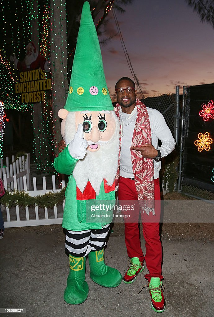 Dwyane Wade makes an appearance on behalf of his Wade's World Foundation at Santa's Enchanted Forest on December 23, 2012 in Miami, Florida.