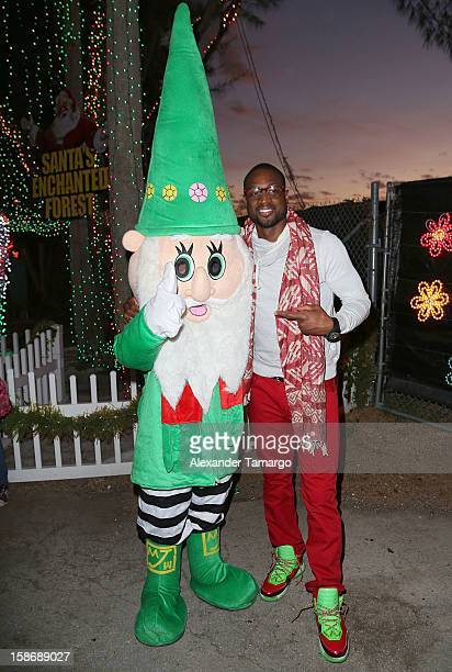 Dwyane Wade makes an appearance on behalf of his Wade's World Foundation at Santa's Enchanted Forest on December 23 2012 in Miami Florida