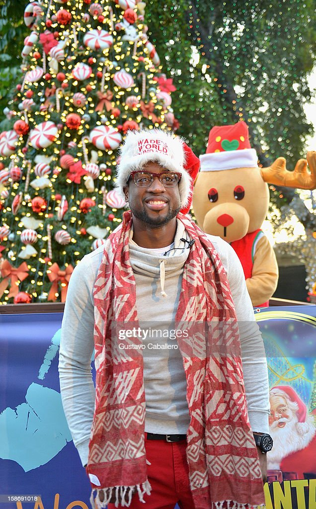 Dwyane Wade makes an appearance on behalf of Wade's World Foundation at Santa's Enchanted Forest on December 23, 2012 in Miami, Florida.