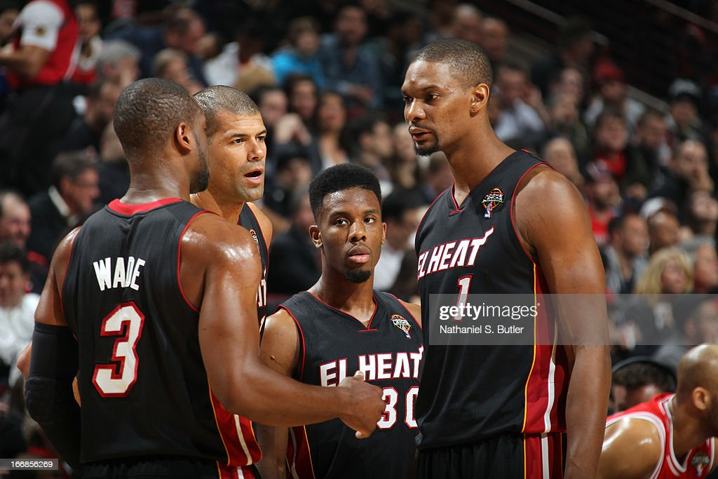 <a gi-track='captionPersonalityLinkClicked' href=/galleries/search?phrase=Dwyane+Wade&family=editorial&specificpeople=201481 ng-click='$event.stopPropagation()'>Dwyane Wade</a> #3 , <a gi-track='captionPersonalityLinkClicked' href=/galleries/search?phrase=Norris+Cole&family=editorial&specificpeople=5770147 ng-click='$event.stopPropagation()'>Norris Cole</a> #30 , <a gi-track='captionPersonalityLinkClicked' href=/galleries/search?phrase=Chris+Bosh&family=editorial&specificpeople=201574 ng-click='$event.stopPropagation()'>Chris Bosh</a> #1 and <a gi-track='captionPersonalityLinkClicked' href=/galleries/search?phrase=Shane+Battier&family=editorial&specificpeople=201814 ng-click='$event.stopPropagation()'>Shane Battier</a> #31 of the Miami Heat huddle against the Chicago Bulls on March 27, 2013 at the United Center in Chicago, Illinois.