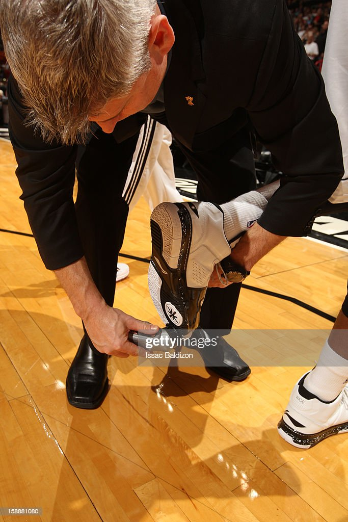 Dwyane Wade #3 of Miami Heat gets court grip applied to his sneakers prior to the game against the Washington Wizards on December 15, 2012 at American Airlines Arena in Miami, Florida.