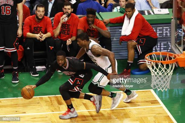 Dwyane Wade of the Chicago Bulls drives against Marcus Smart of the Boston Celtics during the fourth quarter of Game One of the Eastern Conference...