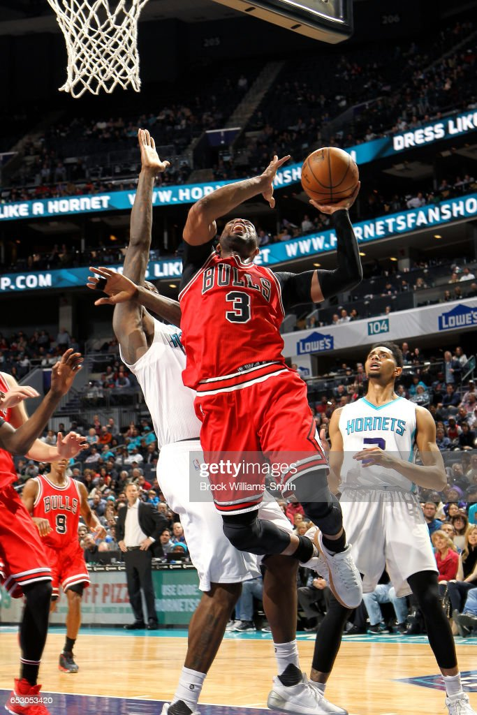 Dwyane Wade #3 of the Chicago Bulls goes for a lay up during the game against the Charlotte Hornets on March 13, 2017 at Time Warner Cable Arena in Charlotte, North Carolina.