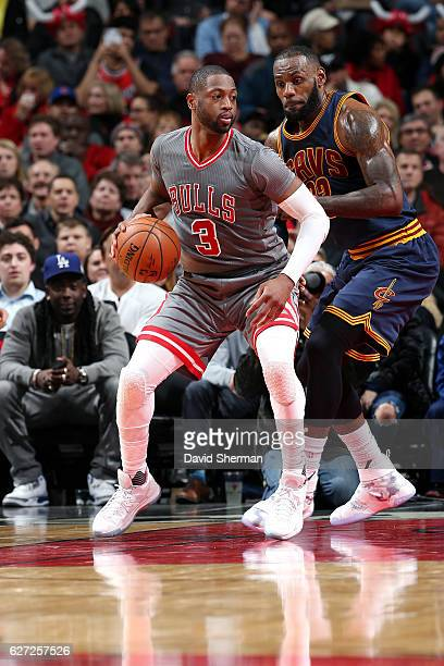 Dwyane Wade of the Chicago Bulls handles the ball during the game against LeBron James of the Cleveland Cavaliers on December 2 2016 at the United...