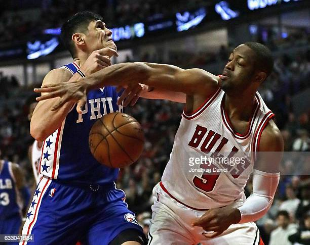 Dwyane Wade of the Chicago Bulls knocks the ball away from Ersan Ilyasova of the Philadelphia 76ers at the United Center on January 29 2017 in...
