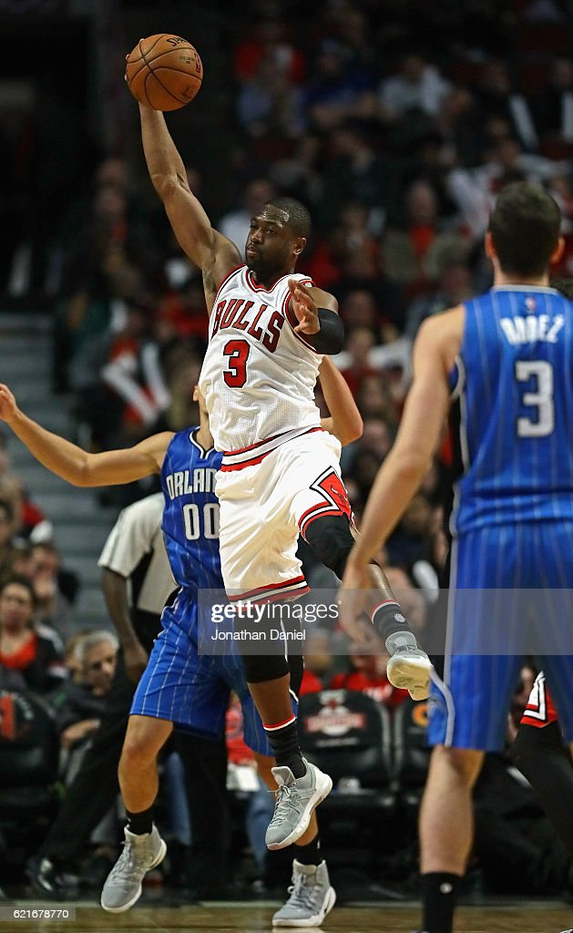 Dwyane Wade #3 of the Chicago Bulls leaps to intercept a pass from Damjan Rudez #3 of the Orlando Magic intended for Aaron Gordon #00 at the United Center on November 7, 2016 in Chicago, Illinois. The Bulls defeated the Magic 112-80.