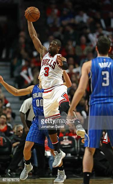 Dwyane Wade of the Chicago Bulls leaps to intercept a pass from Damjan Rudez of the Orlando Magic intended for Aaron Gordon at the United Center on...