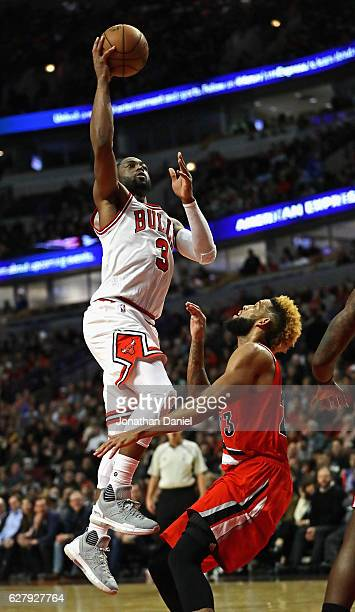 Dwyane Wade of the Chicago Bulls puts up a shot over Allen Crabbe of the Portland Trail Blazers on his way to a gamehigh 34 points at the United...
