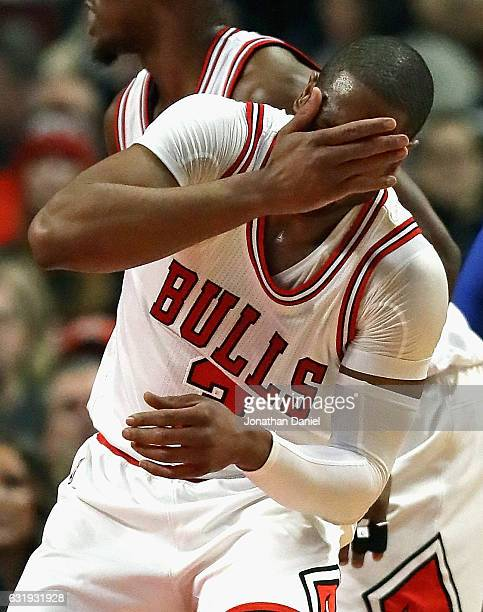 Dwyane Wade of the Chicago Bulls reacts after getting smacked in the face against the Dallas Mavericks at the United Center on January 17 2017 in...