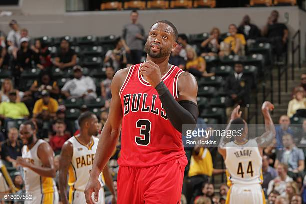 Dwyane Wade of the Chicago Bulls reacts to a play against the Indiana Pacers during a preseason game on October 6 2016 at Bankers Life Fieldhouse in...