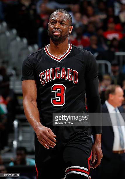 Dwyane Wade of the Chicago Bulls reacts to being charged with a foul during the game against the Atlanta Hawks at Philips Arena on January 20 2017 in...