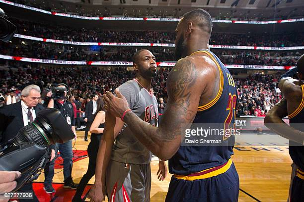 Dwyane Wade of the Chicago Bulls shares a hug with LeBron James of the Cleveland Cavaliers after the game on December 2 2016 at the United Center in...