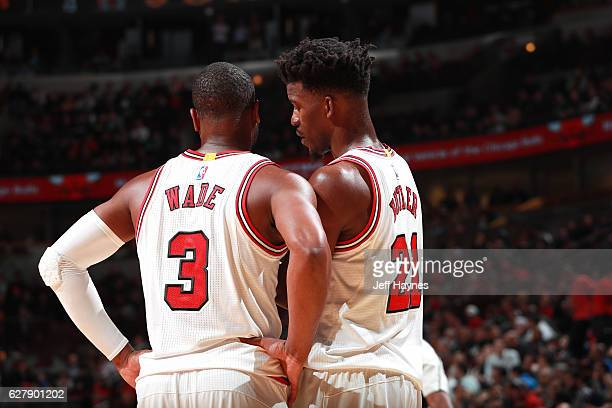 Dwyane Wade of the Chicago Bulls talks with Jimmy Butler of the Chicago Bulls during the game against the Portland Trail Blazers on December 5 2016...