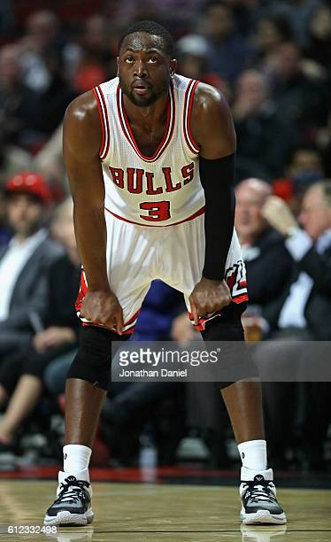 Dwyane Wade of the Chicago Bulls waits for a Milwaukee Buck free throw shot during a preseason game at the United Center on October 3 2016 in Chicago...