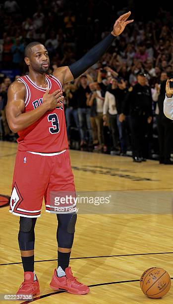 Dwyane Wade of the Chicago Bulls waves to the crowd during the first quarter of the game against the Miami Heat at American Airlines Arena on...