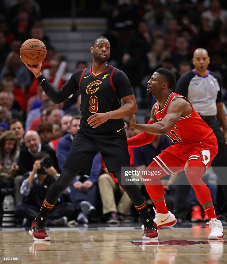 Dwyane Wade #9 of the Cleveland Cavaliers looks to pass as David Nwaba #11 of the Chicago Bulls defends at the United Center on December 4, 2017 in Chicago, Illinois. The Cavaliers defeated the Bulls 113-91.