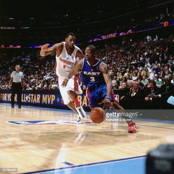 Dwyane Wade of the Eastern Conference AllStars drives against Tracy McGrady the Western Conference AllStars during the 2005 AllStar Game on February...