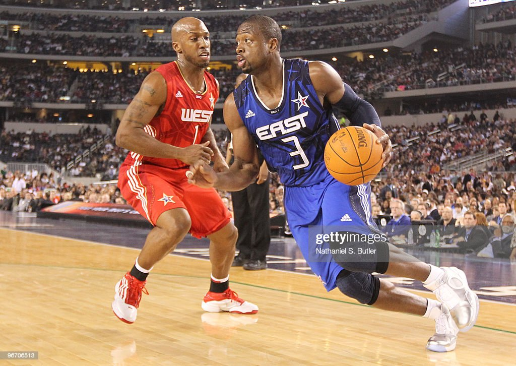 <a gi-track='captionPersonalityLinkClicked' href=/galleries/search?phrase=Dwyane+Wade&family=editorial&specificpeople=201481 ng-click='$event.stopPropagation()'>Dwyane Wade</a> #3 of the Eastern Conference drives against <a gi-track='captionPersonalityLinkClicked' href=/galleries/search?phrase=Chauncey+Billups&family=editorial&specificpeople=201508 ng-click='$event.stopPropagation()'>Chauncey Billups</a> #1 of the Western Conference during the NBA All-Star Game as part of the 2010 NBA All-Star Weekend at Cowboys Stadium on February 14, 2010 in Arlington, Texas.