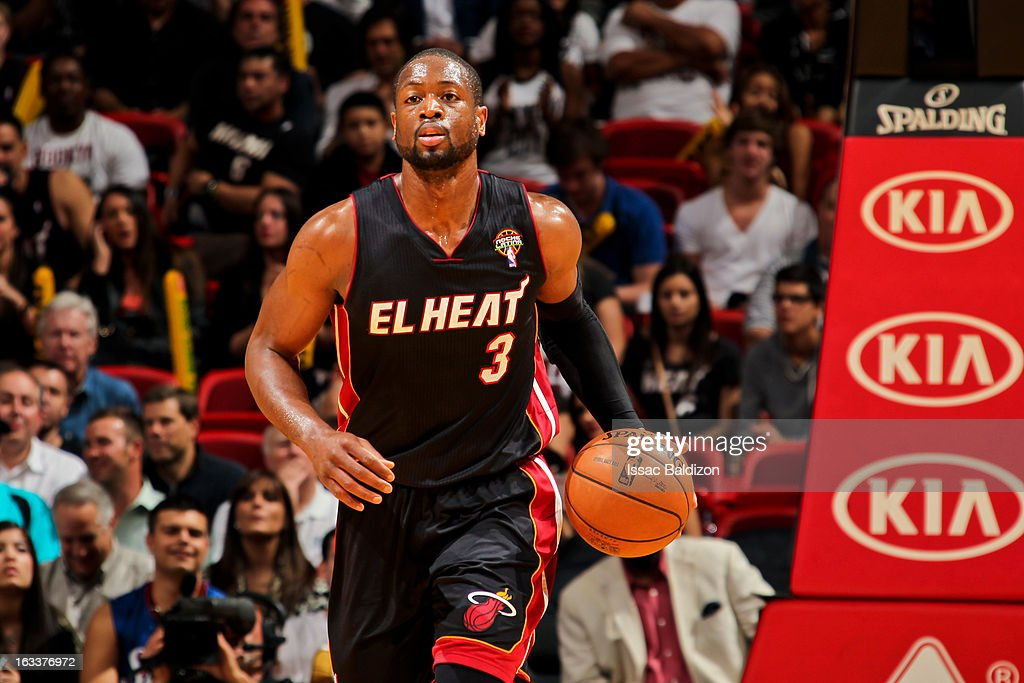 Dwyane Wade #3 of the Miami Heat advances the ball against the Philadelphia 76ers on March 8, 2013 at American Airlines Arena in Miami, Florida.