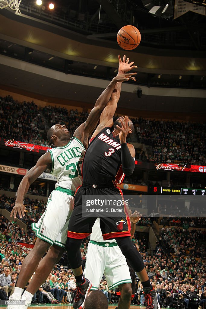 Dwyane Wade #3 of the Miami Heat and Brandon Bass #30 of the Boston Celtics battle for a rebound during the game on January 27, 2013 at TD Garden in Boston, Massachusetts.