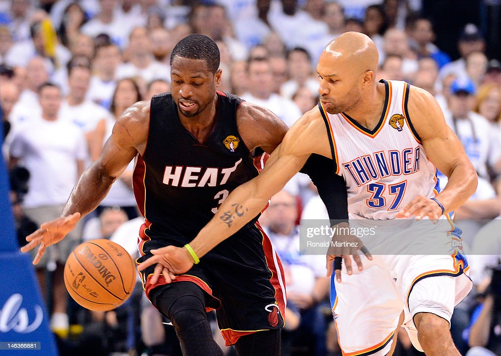 <a gi-track='captionPersonalityLinkClicked' href=/galleries/search?phrase=Dwyane+Wade&family=editorial&specificpeople=201481 ng-click='$event.stopPropagation()'>Dwyane Wade</a> #3 of the Miami Heat and <a gi-track='captionPersonalityLinkClicked' href=/galleries/search?phrase=Derek+Fisher&family=editorial&specificpeople=201724 ng-click='$event.stopPropagation()'>Derek Fisher</a> #37 of the Oklahoma City Thunder go after the ball late in the fourth quarter in Game Two of the 2012 NBA Finals at Chesapeake Energy Arena on June 14, 2012 in Oklahoma City, Oklahoma.