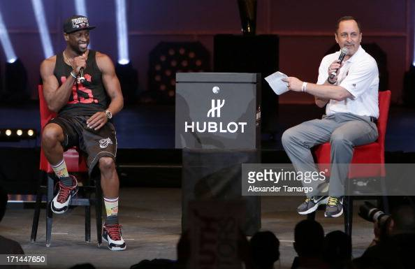 Dwyane Wade of the Miami Heat and Eric Reid attend the NBA Championship victory rally at the AmericanAirlines Arena on June 24 2013 in Miami Florida...