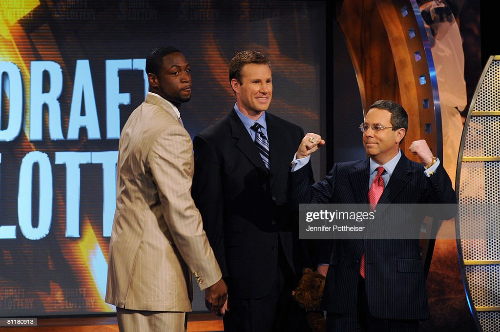 Dwyane Wade of the Miami Heat, and Fred Hoiberg, Assistant General Manager of the Minnesota Timberwolves watch Steve Schanwald, Executive Vice President of Baketball Operations of the Chicago Bulls, celebrate during the 2008 NBA Draft Lottery at the NBATV Studios on May 20, 2008 in Secaucus, New Jersey.