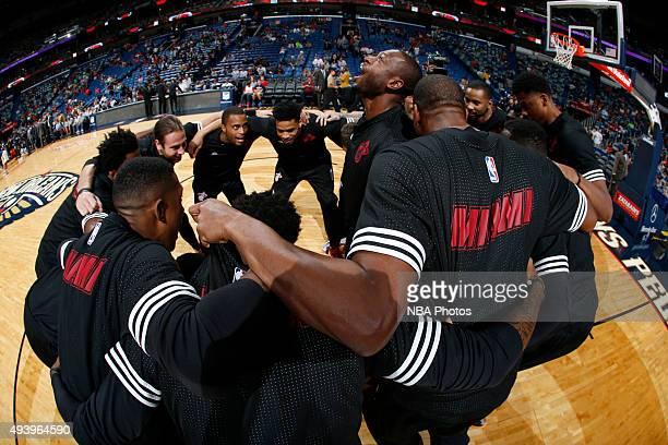 Dwyane Wade of the Miami Heat and his teammates huddle before a preseason game against the New Orleans Pelicans on October 23 2015 at the Smoothie...