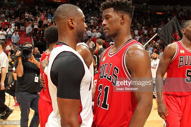 Dwyane Wade of the Miami Heat and Jimmy Butler of the Chicago Bulls are seen after the game on April 7 2016 at AmericanAirlines Arena in Miami...