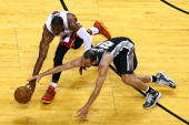 Dwyane Wade of the Miami Heat and Manu Ginobili of the San Antonio Spurs go after a loose ball in the first half during Game Two of the 2013 NBA...