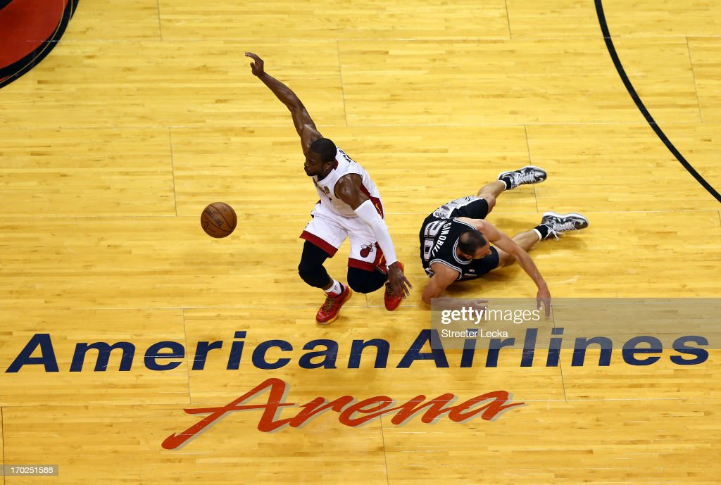 Dwyane Wade #3 of the Miami Heat and Manu Ginobili #20 of the San Antonio Spurs go after a loose ball in the first half during Game Two of the 2013 NBA Finals at AmericanAirlines Arena on June 9, 2013 in Miami, Florida.