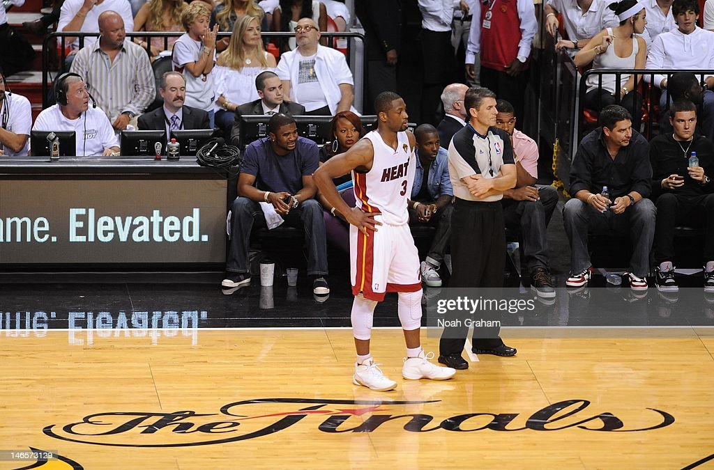Dwyane Wade of the Miami Heat and referee Scott Foster look on during Game Four of the 2012 NBA Finals between the Miami Heat and the Oklahoma City...