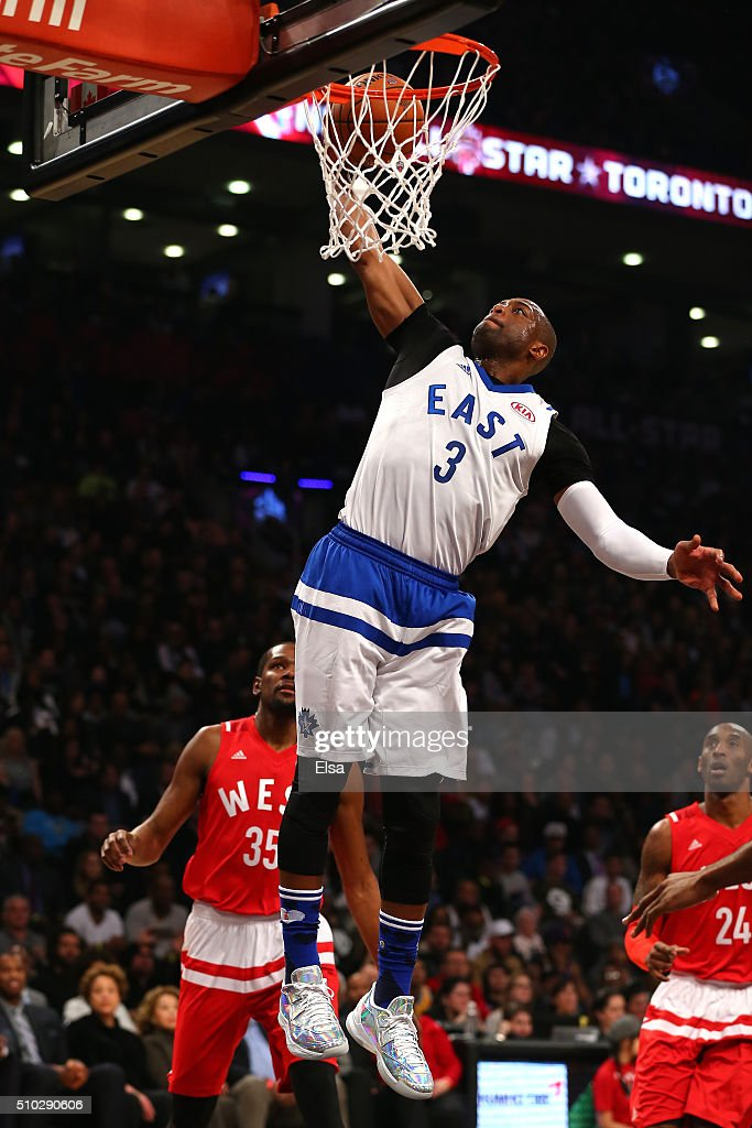 Dwyane Wade of the Miami Heat and the Eastern Conference goes up for a dunk in the first half against the Western Conference during the NBA AllStar...