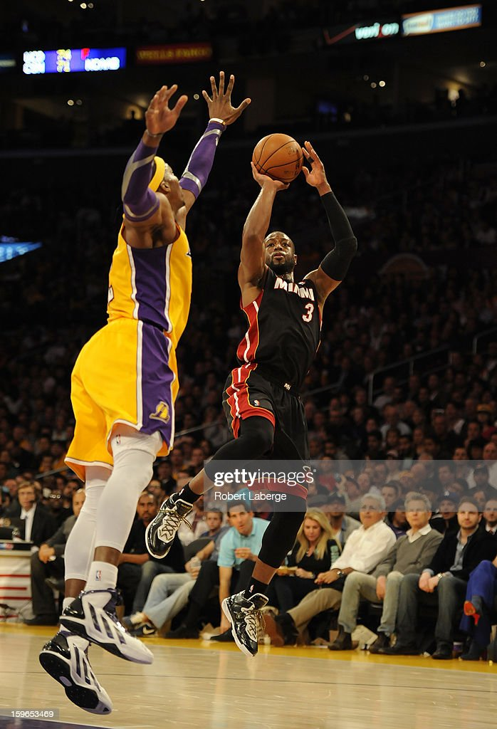 Dwyane Wade #3 of the Miami Heat attempts a shot as Dwight Howard #12 of the Los Angeles Lakers tries to block it at Staples Center on January 17, 2013 in Los Angeles, California.