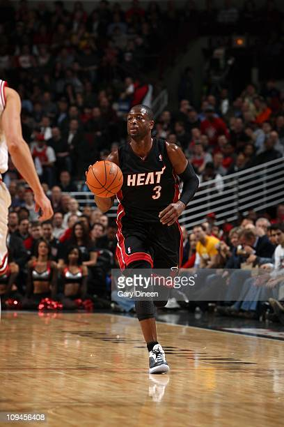 Dwyane Wade of the Miami Heat brings the ball up court against the Chicago Bulls during the NBA game on February 24 2011 at the United Center in...