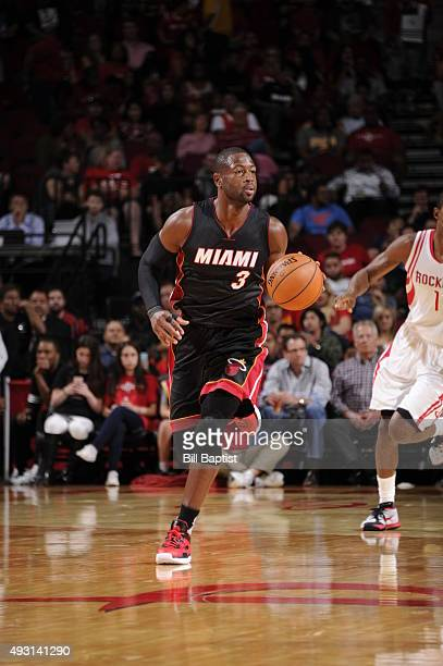 Dwyane Wade of the Miami Heat brings the ball up court against the Houston Rockets on October 17 2015 at the Toyota Center in Houston Texas NOTE TO...
